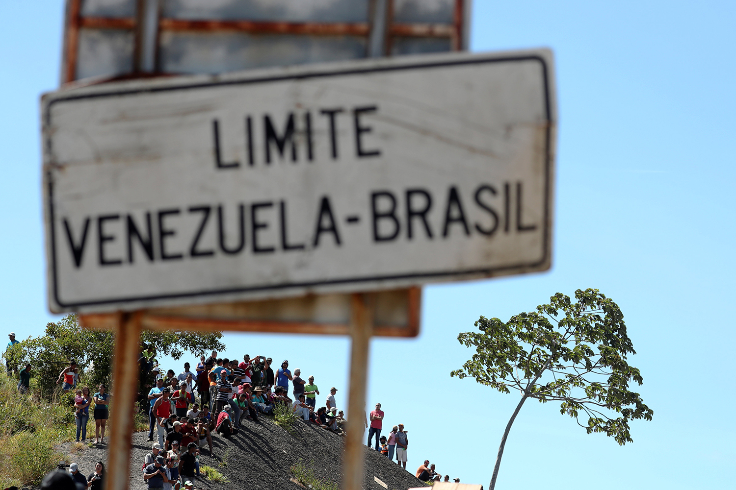 People gather at the border between Venezuela and Brazil in Pacaraima, Roraima state, Brazil February 23, 2019.  REUTERS/Ricardo Moraes